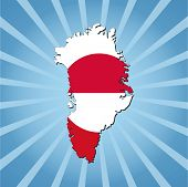 Greenland map flag on blue sunburst illustration