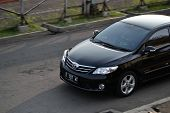 black colored toyota corolla altis