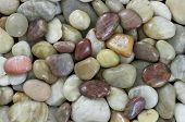 Natural colored small stones abstract background