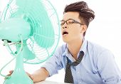 Young Business Man Use Fans To Cool Down
