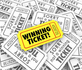 image of gambler  - One winning ticket on pile of losing entries in lottery or raffle for cash or prizes - JPG