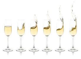picture of champagne color  - Six champagne flutes with splashing champagne - JPG