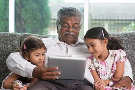 foto of grandparent child  - Portrait Indian family at home - JPG