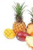 exotic fruit food - a lot of fresh raw tropical fruits include pineapple and mango isolated over white background