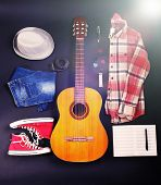 Musical equipment, clothes and footwear on dark background