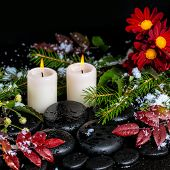 Winter Spa Still Life Of Evergreen Branches, Leaves With Drops, Snow, Candles And Chrysanthemum On Z