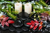 Winter Spa Still Life Of Red Leaves With Drops, Snow, Evergreen Branches And Candles On Zen Stones,