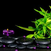 Beautiful Spa Concept Of Zen Basalt Stones With Drops, Lilac Candle, Beads And Bamboo, Closeup