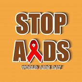 World Aids Day concept with stylish text and red ribbon of aids awareness on yellow background.