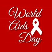 Beautiful text of World Aids Day with awareness ribbon on red background.
