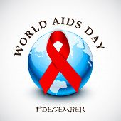 World Aids Day concept with glossy ribbon of aids awareness on globe.