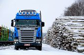 Blue Scania V8 Logging Truck At Snowy Railway Timber Yard
