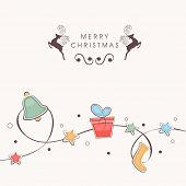 Beautiful ornaments tied with stars decorated rope on beige background for Merry Christmas celebrations.