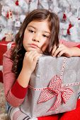 foto of sad christmas  - Sad Little Girl with a Christmas gift - JPG