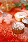 chocolate tartlets in festive golden red style, shallow dof