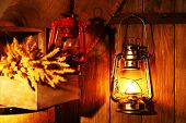 Lantern hanging on hook on wooden wall