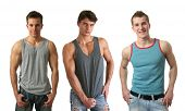 Three young sexy men wearing sleeveless shirts isolated on white