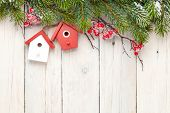 Christmas wooden background with fir tree and birdhouse decor. View from above with copy space
