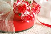 carnation flowers and gift box