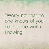 Inspirational quote by ancient philosopher Confucius on earthy background