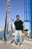 image of spearfishing  - angler fish catch albacore tuna and spearfish mediterranean - JPG