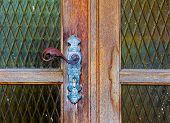 Iron Door Handle On Old Wooden Door