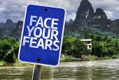 Face Your Fears sign with a rural background