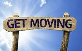 Get Moving sign on a summer day