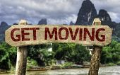 Get Moving sign with a forest background