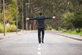 Businessman walking in the road line