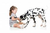 child girl playing puppy dog