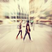 Abstract blurred image of people in the city.