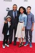 LOS ANGELES - NOV 23:  Miles Brown, Anthony Anderson, Yara Shahidi, Marcus Scribner at the 2014 American Music Awards - Arrivals at the Nokia Theater on November 23, 2014 in Los Angeles, CA