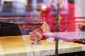 Woman with glass of wine in restaurant