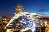 Beijing,China-July 13,2014:cityscape and famous landmark building,WangJing Soho at night.
