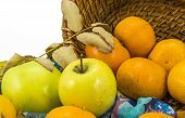 Apples, Tangerines And A Wicker Basket On A White Background