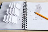 picture of applique  - Applique paper with building and solar panels in notebook - JPG