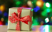 Gift box on Christmas tree lights background