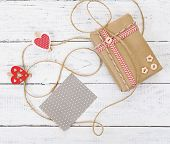Gift box with card on wooden background