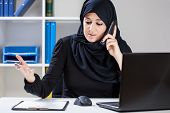 Muslim Businesswoman During Work