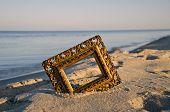 Vintage Golden Picture Frame On Sea Resort Beach