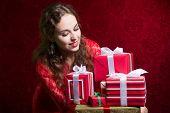 Beautiful Girl Looking At Gifts.