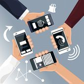 Hands holding smartphones telephones that