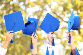 stock photo of graduation gown  - High school graduation hats high - JPG