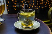 picture of brew  - cup brewing tea in a cafe on the background of lights - JPG