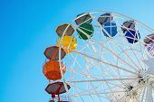 stock photo of color wheel  - Detail of a colurful ferris wheel seen at a fair - JPG