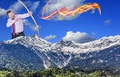 image of archery  - Businessman practicing archery with mountain valley foreground - JPG