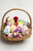 picture of boll  - Easter egg made of multicolored crochet yarn on a white background with bolls skeins and crochet hooks - JPG