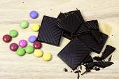 picture of bonbon  - Dark chocolate with pile of colored bonbons - JPG