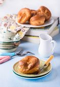 foto of custard  - Choux pastry eclair ring with custard cream served for tea selective focus - JPG